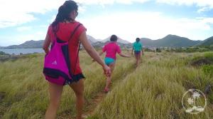 Hiking on Pinel Island, walking through the meadow.