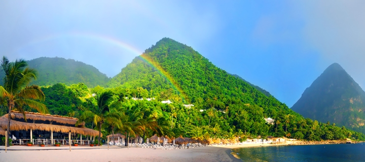 Rainbow over Sugar Beach with Gros Piton in the background, St. Lucia.